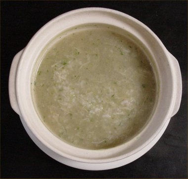 [ Porridge of rice, the adductor muscle and leaf of a japanese radish ]